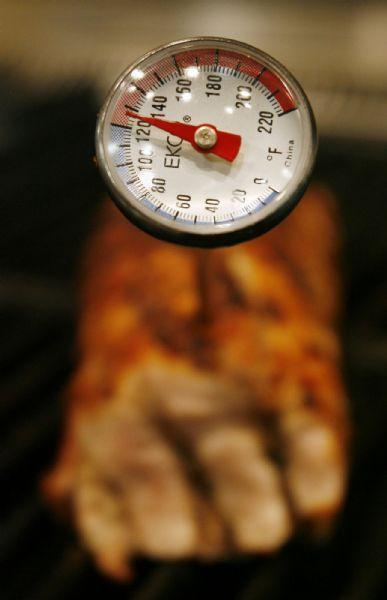 Salt Lake City -  A thermometer is placed in a piece of pork tenderloin by Chef Cathie Mooere as she grills the meat at the Viking Cooking School in Salt Lake City Friday May 15, 2009.  Steve Griffin/The Salt Lake Tribune 5/15/09