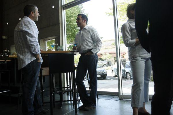 Mike Thompson, center, talks with Jay Shaffer, left, during a fundraiser at The Metropolitan May 21, 2009. Thompson was the executive director of Equality Utah for the past four years and is moving to San Francisco at the end of the month.