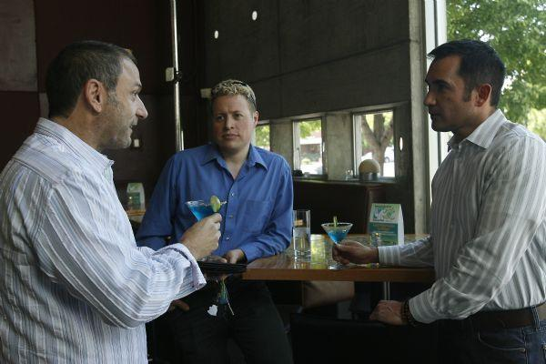 Mike Thompson, right, talks with Jay Shaffer, left, and Will Carlson, center, during a fundraiser at The Metropolitan May 21, 2009. Thompson was the executive director of Equality Utah for the past four years and is moving to San Francisco at the end of the month.