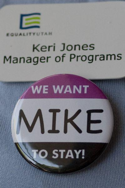 Keri Jones, Manager of Programs, wears a 'We Want Mike to Stay!