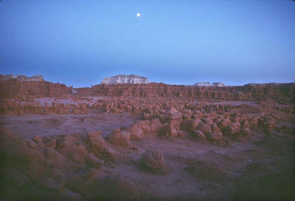 Moon rises over Goblin Valley State Park.