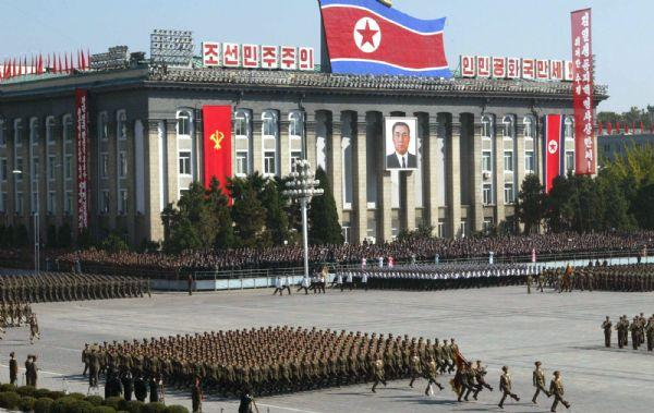 File - In this Oct. 10, 2005 file photo, North Korean soldiers parade in front of Workers' Party of Korea headquarters building in Pyongyang, North Korea, to mark the 60th founding anniversary of the ruling Workers' Party. Analysts say North Korea has an exclusive department, known as Room 39 or Bureau 39, to control illicit business activities such as counterfeiting, drug smuggling and weapons sales. Room 39 has 120 foreign trade companies under its jurisdiction, Lim Soo-ho, a research fellow at the Samsung Economic Research Institute in Seoul, told The Associated Press. Though the bureau formally falls under the ruling Workers' Party, in reality it is directly controlled by North Korean leader Kim Jong Il, he said. (AP Photo/Xinhua, Ji Xinlong, File)