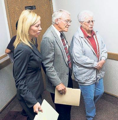 Harold J. Lyman, middle, of Blanding, enters the courtroom with his wife, right, and his lawyer. Some defendants charged in the artifact-looting probe made initial appearances in federal court in Moab on Thursday. Lyman, 78, pleaded not guilty to trafficking in stolen artifacts.