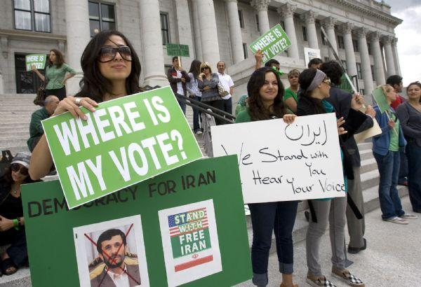 Sahar Mirmontazeri, left, was among  30 people demonstrating on the  steps of the Utah State Capitol  Wednesday protesting the Iran election.   She moved with her family to the United States when she was 11.  She's been here for 19 years.   She still has relatives in Iran and hopes for democracy to take hold.   Al Hartmann/The Salt Lake Tribune    6/17/09