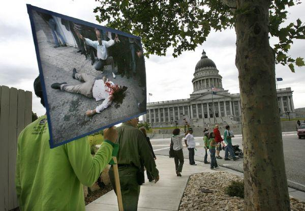 Many of the people rallying in Salt Lake City Saturday in support of protestors in Iran, carried large photos of shots taken on the streets of Tehran.