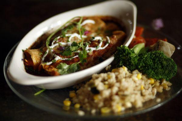 The steak enchiladas with jack cheese, organic cilantro and red chili sauce ($23) at Hell's Backbone Grill.