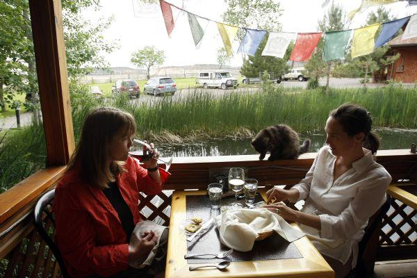 Stephanie Lujan, left, and Anne-Marie Cory, of Boulder, Col., eat dinner on the patio at Hell's Backbone Grill June 4, 2009. Hell's Backbone Grill uses sustainably grown vegetables, herbs and flowers from the restaurant's own no-harm organic farm and on-site gardens, and Boulder-raised grass fed and finished local lamb and beef. They also keep bees for honey and pollination and tend over 50 heritage-breed laying hens who provide eggs. The farm is worked organically, employing principles of sustainabilty and Buddhist values of right livelihood.          Chris Detrick/The Salt Lake Tribune