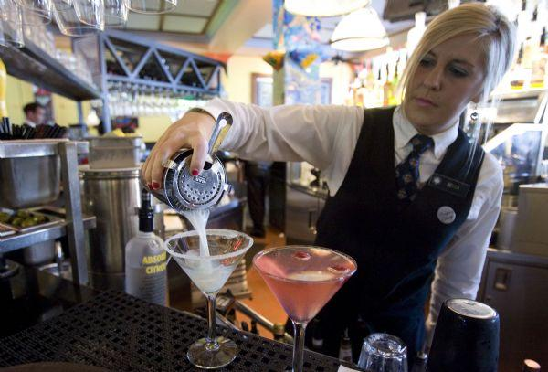 Bartender Becca Jones prepares drinks at the Oyster Bar.