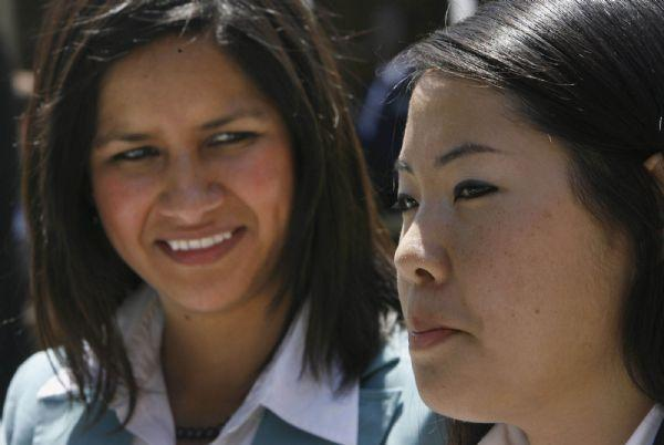 Gazelem Munoz (left) of Mexico and Unbyul Cho, of South Korea, who both serve in the Salt Lake City, Temple Square Mission, talk with reporters at the Missionary Training Center in Provo during a press conference announcing that a million missionaries have served since the organizaioin of the church June 25, 2007.   Steve Griffin/The Salt Lake Tribune