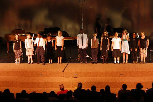 Students take a bow after performing