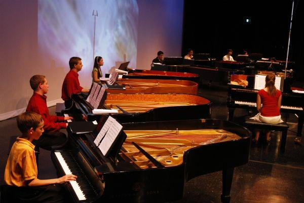 Alex Mietchen, 12, far left, performs