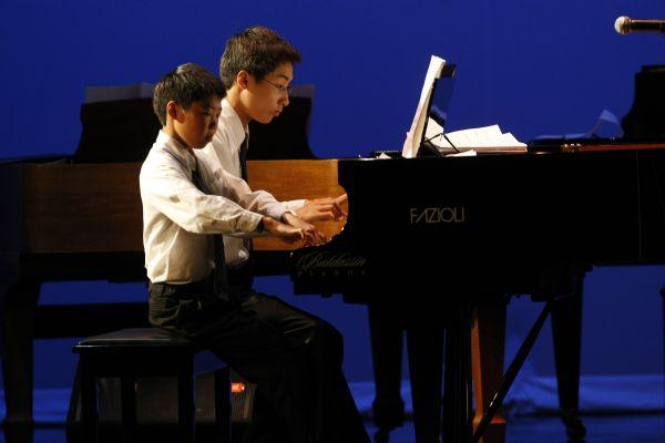 Jonathan Chang, right, and Anderson Chang, perform