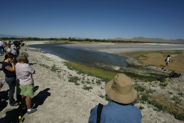 Catherine Smith, center, watches Wednesday as water flows into the South Shore Preserve on the Great Salt Lake for the first time in 2,600 years. The National Audubon Society opened the preserve.