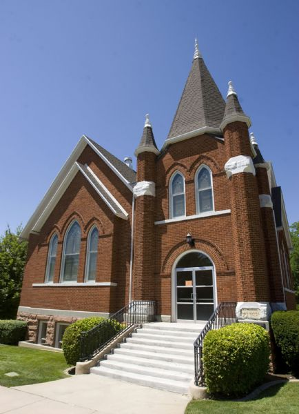 The Salt Lake 27th Ward at 185 P Street in Salt Lake City built in 1902 shows  distinctive Gothic red brick with a corner tower .  It sits next to the Salt Lake Cemetery.  A pipe organ at the front of the chapel was later added.