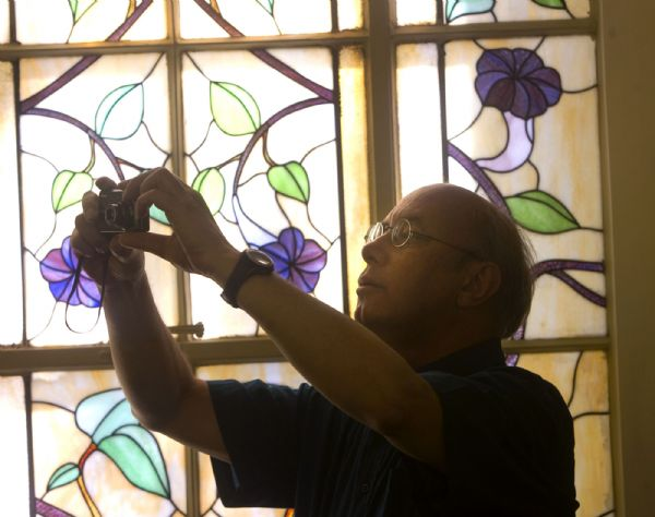 Paul Anderson, an architectural historian who teaches at BYU, takes a picture inside the Salt Lake 20th Ward's chapel bathed in the soft light of the distinctive stained glass windows.  The chapel is at 107 G Street  in Salt Lake City.