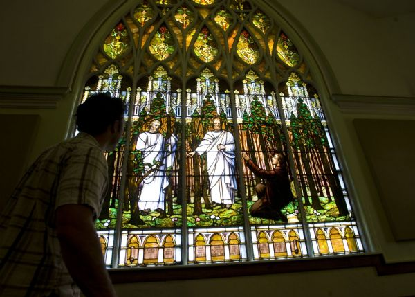 The Salt Lake Second Ward at 704 S. 500 E. shows a distinctive Gothic Revival style with a corner tower.  It's  stained-glass window of Joseph Smith's First Vision is awe inspiring.  Clayton Vance, a graduate student in architecture at Notre Dame looks at the window from inside the chapel.