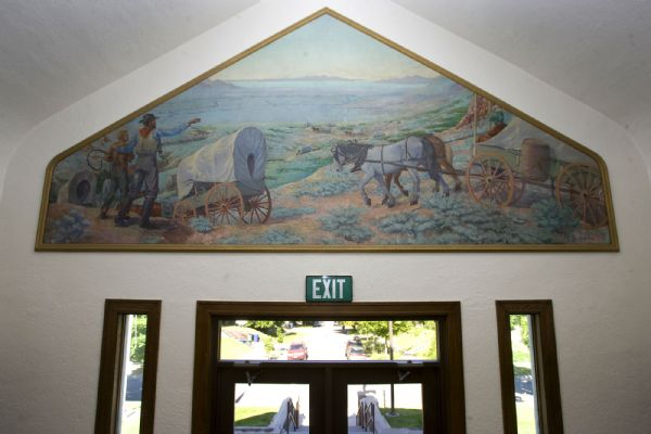 The Highland Park Ward at 2535 Douglas Street in Salt Lake City built in 1923-4 has a distinctive Tudor style.  It also contains some of the best artwork of any Salt Lake chapel like this unusually shaped painting of the pioneers entering Salt Lake Valley over the front doorway.  It was painted by JB Fairbanks.