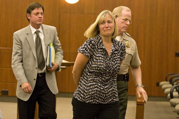 Linda Richins Nef is lead away in handcuffs after receiving a 3-year to life sentence for attempted aggravated sexual abuse of a child, at Davis Justice Center in Farmington Tuesday, July 21, 2009.