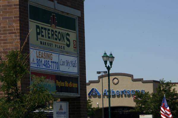 A sign for Peterson's Marketplace in Riverton across the street from Albertsons' Tuesday July 28, 2009.  Associated Foods Stores is poised to jump ahead of the Wal-Mart and Smith's Food & Drug to become the state's No. 1 grocer with its purchase of 36 Albertsons stores in Utah.  Officials from Associated Foods and Albertsons' parent company, Supervalu Inc., said they expect to complete the sale, announced Tuesday within the next few months, though the deal is subject to review by regulators. Under the sale, Supervalu would receive $150 million in after-tax proceeds.    Photo by Chris Detrick/The Salt Lake Tribune