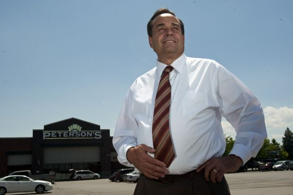 Monte Peterson poses for a portrait in front of his store Peterson's Marketplace in Riverton Tuesday July 28, 2009.  Peterson is also the Chairman of the Board of Associated Food Stores, Inc.  Associated Foods Stores is poised to jump ahead of the Wal-Mart and Smith's Food & Drug to become the state's No. 1 grocer with its purchase of 36 Albertsons stores in Utah.  Officials from Associated Foods and Albertsons' parent company, Supervalu Inc., said they expect to complete the sale, announced Tuesday within the next few months, though the deal is subject to review by regulators. Under the sale, Supervalu would receive $150 million in after-tax proceeds.    Photo by Chris Detrick/The Salt Lake Tribune