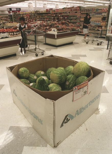 Shoppers in the produce isle of Albertson's.