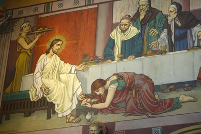 A mural showing St. Mary Magdalene washing the feet of Jesus, in the Cathedral of the Madeleine.