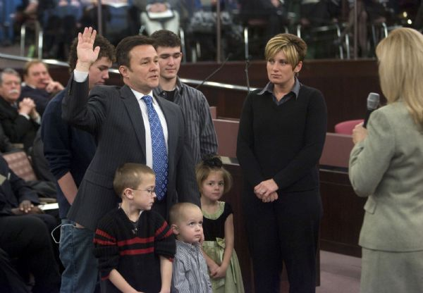Salt Lake County Councilman Michael H, Jensen is sworn in, surrounded by his family, in the County Council chambers on Monday.
