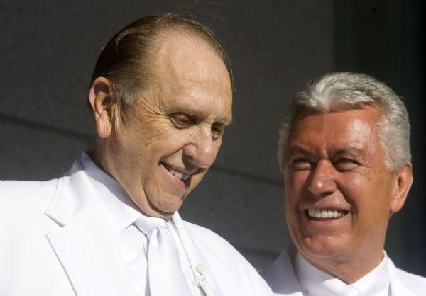 President Thomas S. Monson, left, and Second Counselor Deiter Uchtdorf chat during the traditional mortar ritual at the first dedication session for the Oquirrh Mountain Temple, the LDS Church's fourth temple in the Salt Lake Valley and 130th in the world.