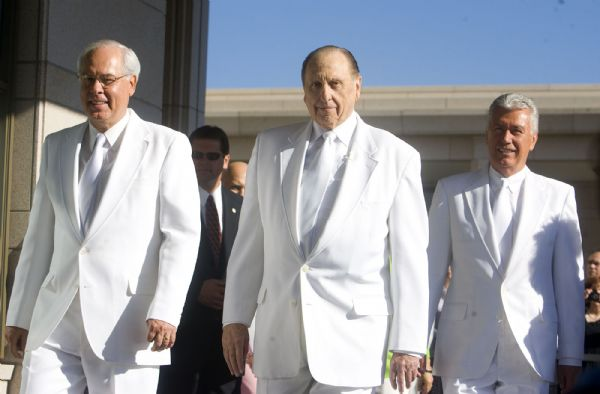 William R. Walker, of the First Quorom of the Seventy and director of the LDS Church Temple Department, left, President Thomas S. Monson and Second Counselor Deiter Uchtdorf presided over the traditional mortar ritual at the dedication of the Oquirrh Mountain Temple.