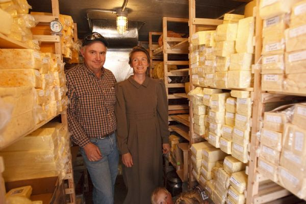Winford Barlow works in his cheese cold storage room. Winford and Carolena Barlow run the Finney Farm Home Dairy in Hildale, where they sell raw milk, cheese and other products.
