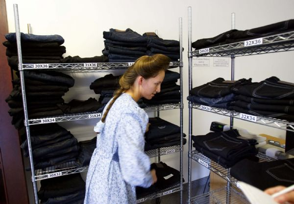 Mirinda Barlow works in her Hildale shop, where she sells jeans under the label Most Wanted Jeans.