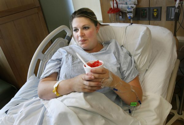 Sarah Anderton nibbles cherry-flavored ice chips while in labor at Intermountain Medical Center earlier this month. Eager to have her daughter, Allegra, before her husband left town on business, she asked to be induced early. Her doctor convinced her to wait until her 39th week of pregnancy, when data shows fewer complications occur.  Scott Sommerdorf | The Salt Lake Tribune