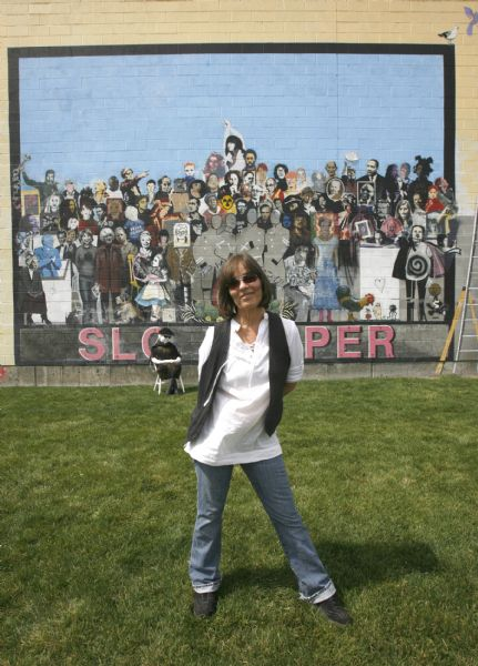 Jann Haworth in front of her mural on 400 West in Salt Lake, along with one of her old lady sculptures, Wednesday, September 2,  2009.  Jann Haworth was one of the original artists behind The Beatles' most famous album cover. Today a resident of Sundance who still creates art that finds exhibitions nationally and internationally. Rick Egan/The Salt Lake Tribune