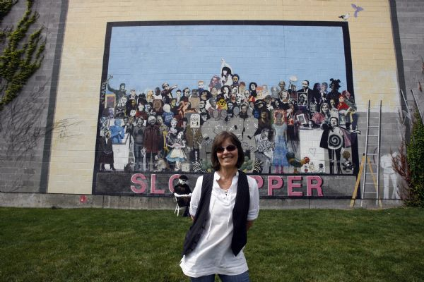 Jann Haworth in front of her mural on 400 West in Salt Lake.  Haworth was one of the original artists behind The Beatles' most famous album cover. Today a resident of Sundance who still creates art that finds exhibitions nationally and internationally.
