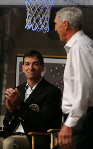 Above, retired Utah Jazz point guard John Stockton smiles as Utah Jazz head coach Jerry Sloan is introduced during the Hall of Fame jacket ceremony.