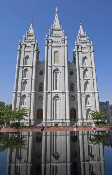 Pedestrians stroll past The Church of Jesus Christ of Latter-day Saint?s historic temple in Salt Lake City. People in the Mormon community, including college students, were the targets of a fraud perpetrated by record producer Henry Jones and Tri Energy Inc., the U.S. Securities and Exchange Commission alleges.