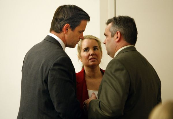 Civil attorney Andrew Deiss and defense attorneys Susanne Gustin and Roger Kraft (left to right) confer during the trial of David James