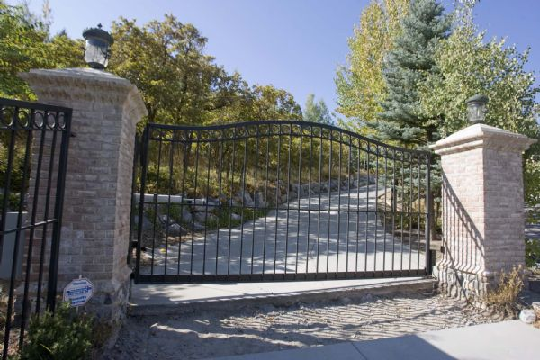 The former mansion home of Rick Koerber in Alpine, Utah. The home is behind security gates and obscured by trees.  Monday, September 28,2009  photo:Paul Fraughton/ The Salt Lake Tribune