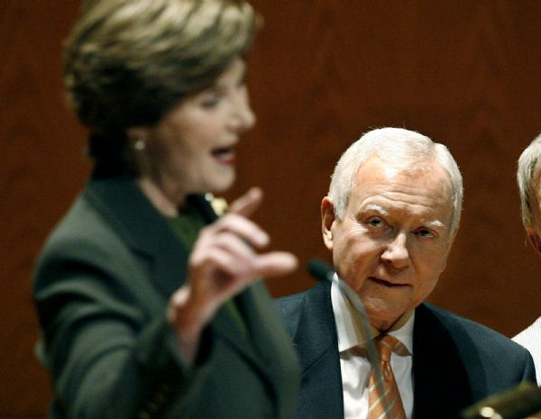 Senator Orrin Hatch (R-Utah), listens at right as former First Lady Laura Bush speaks at the annual Utah Women?s Conference - ?Discovering the Diversity and Unity of Women? which took place Monday Oct. 26, 2009, at Abravanel Hall in Salt Lake City. Senator Orrin Hatch (R-Utah) and his wife, Elaine attended as well as pianist Roger Williams, and Utah's first lady Jeanette Herbert.