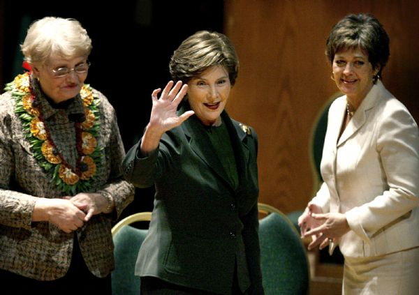 LAURA BUSH  Former First Lady Laura Bush waves to the crowd as she leaves the stage at  the annual Utah Women?s Conference - ?Discovering the Diversity and Unity of Women? which took place Monday Oct. 26, 2009, at Abravanel Hall in Salt Lake City. Senator Orrin Hatch's wife, Elaine is at left, and Utah's first lady Jeanette Herbert is at right.