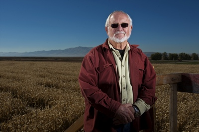 Farmer Charlie Black, with with Antelope Island and the Great Salt Lake in the background, has seen the cycles in action for about 50 years, with the Great Salt Lake threatening to flood his farm some years and low reservoirs cutting off irrigation water on others.