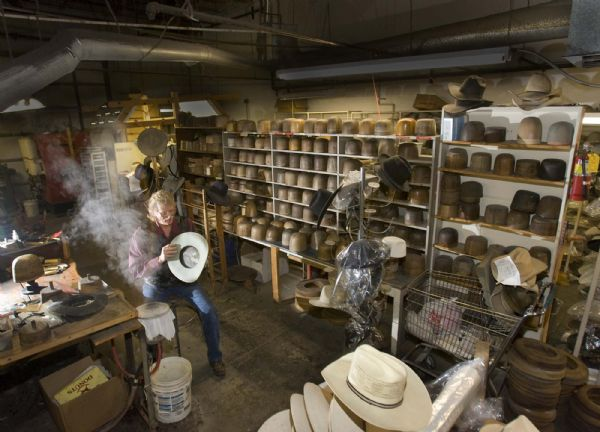 Jim Case sits at a blocking table that dates to 1880  as he works on a hat on  Tuesday, October 27,2009  photo:Paul Fraughton/ The Salt Lake Tribune