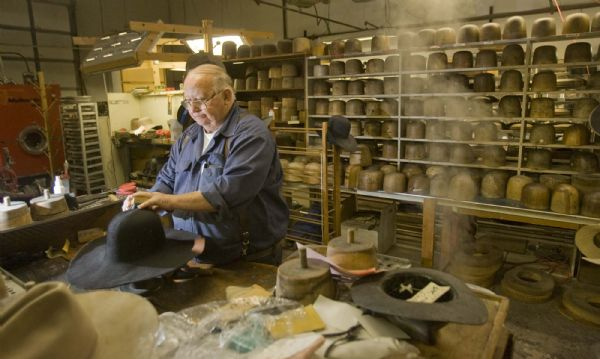 Jim Whittington, who owns JW Hats on Redwood Road,  works at the blocking table in his shop. on  Tuesday, October 27,2009  photo:Paul Fraughton/ The Salt Lake Tribune