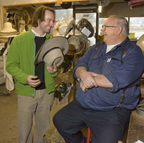 Brad Hutchison, an enthusiastic customer of JW Hats  stops by the shop to get one of his hats adjusted and share a few laughs with owner Jim Whittington on  Tuesday, October 27,2009  photo:Paul Fraughton/ The Salt Lake Tribune