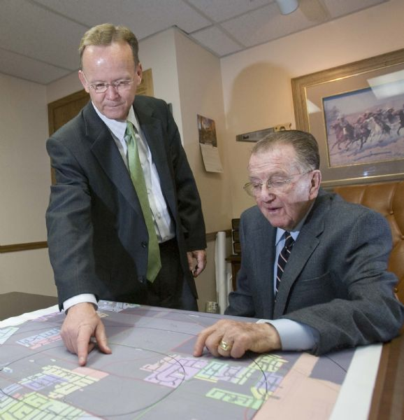 Stuart Adams (left) works with his father Dave Adams at their office in Kaysville on Monday. Stuart Adams recently took his seat as Utah's newest state senator.