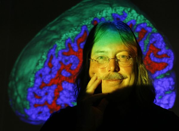 Christopher Johnson, a professor of computer science at the University of Utah is shown with an image of a brain projected in one of the school's labs.  He is the founder of the U.'s Center for Scientific Computing and Imaging, Johnson is a pioneering expert in visualization to solve tough biomedical and engineering problems., Thursday, 10/22/09.