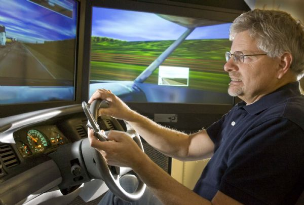 University of Utah psychology professor, David Strayer shows some tension as he tries to drive and text message at the same time. Using a driving simulator to test subjects,Stayer has been doing research on distracted driving.  Wednesday, October 14,2009  photo:Paul Fraughton/ The Salt Lake Tribune