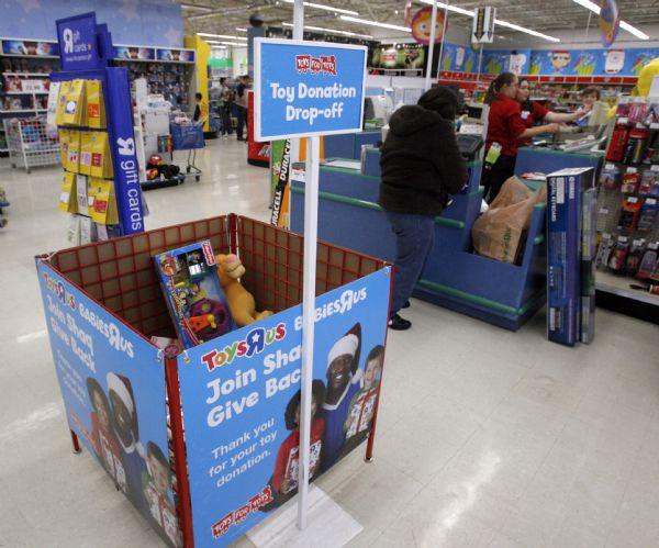 The drop box at Toys R Us in West Valley City, is filling up again, in early November, even though the Marines, emptied the bin only a day before.