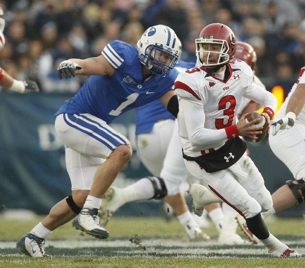 Utah quarterback Jordan Wynn (3) comes under pressure from BYU linebacker Jordan Pendleton (1) during the second quarter of the BYU Utah game at Lavell Edwards Stadium in Provo, Utah, Saturday, November 28, 2009.