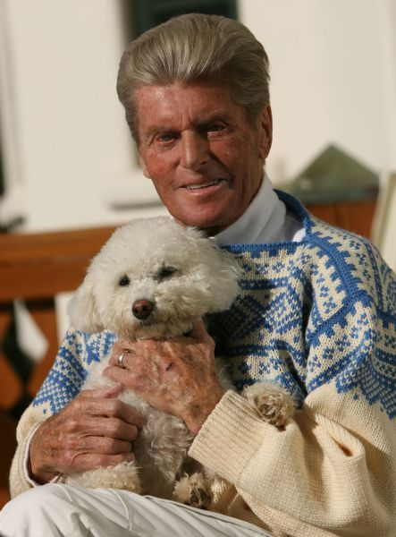 Stein Eriksen, 1952 Olympic medalist who is almost 82 years old, is skiing slower these days and wearing a helmet, but still eager to take to the slopes again in his 38th winter in Utah. Eriksen is holding the newest addiition to the family, Chloe, a Bishon Frise.
